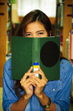 Library. Portrait of asia student use a book close face Stock Images