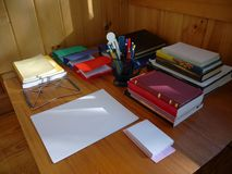 Library: ready to study. Library desk laid out with books, pens, paper in preparation for studying Royalty Free Stock Photo