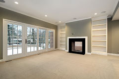 Library in remodeled home. With black fireplace Stock Photography