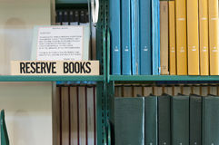 Library reserved book shelf. Research library scientific journal publications and reserved book shelf Royalty Free Stock Image