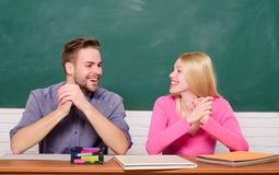 Library romance. Happy couple. Student life. Lesson and blackboard. Teachers day. Couple of man and woman in classroom. Library romance. Happy couple. Student stock photos