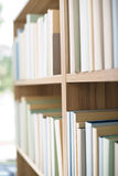 Library -  row of books on bookshelf Royalty Free Stock Images