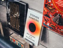 Library selling Brief Answers to the Big Questions by Stephen Hawking. Paris, France - Dec 16, 2018: Street view of boockstore stand with cover of Brief Answers royalty free stock photo
