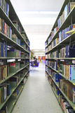 Library setting with books and reading material Stock Photography
