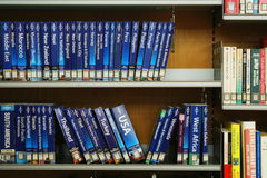 Library Shelves full of Travel Books. Library shelves containing travel guides in a modern library in Japan. Photo taken April 2016 Royalty Free Stock Photos