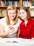 Library - Smart Phone Use Royalty Free Stock Image