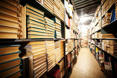 Library stand. Photo of bookshelves of big library in educational institution Royalty Free Stock Photography