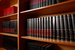 Library stand. Photo of shelves with books in big library of educational institution royalty free stock image