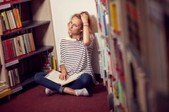 In the library, student girl or young woman with books Stock Photos