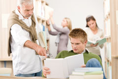 Library - student with mature professor Stock Images