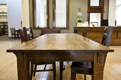 Library table. A old reading table with chairs in a public library royalty free stock photography