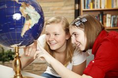 Library Teens Looking at Globe Royalty Free Stock Images