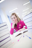 In the library - very tired/exhausted Stock Images