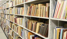 Library. View of book shelve in the library Stock Photos