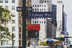 Library Way road sign next to the NY Public Library and street Royalty Free Stock Photo