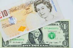 Libras británicas y dólar billetes de banco Imágenes de archivo libres de regalías
