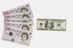 Libras británicas y dólares Imagenes de archivo