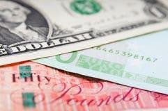 Libras de euros y dólares Foto de archivo libre de regalías