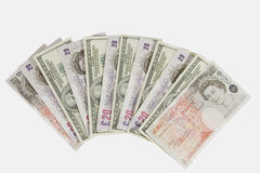 Libras e dólares Imagens de Stock