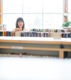 Librería de Choosing Book In del estudiante Foto de archivo libre de regalías