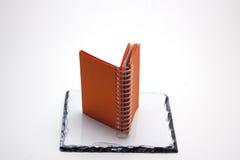 Libreta anaranjada imágenes de archivo libres de regalías
