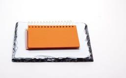 Libreta anaranjada Fotografía de archivo