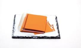 Libreta anaranjada imagenes de archivo