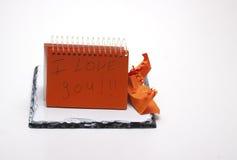 Libreta anaranjada Imagen de archivo libre de regalías