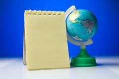 Libreta con el globo Fotografía de archivo libre de regalías