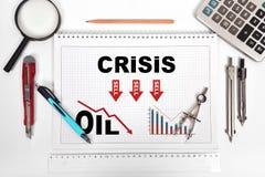 Libreta con la carta de la crisis del petróleo Foto de archivo