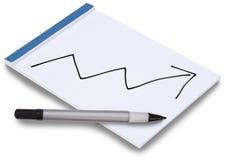 Libreta con la flecha del gráfico de asunto para arriba Imagen de archivo libre de regalías
