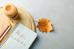 Libreta con la inscripción y una vela Imagen de archivo libre de regalías