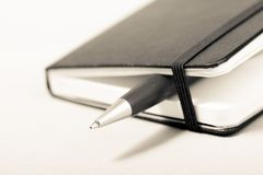 Libreta con la pluma Imagen de archivo