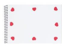 Libreta con los botones en forma de corazón rojos Fotografía de archivo libre de regalías
