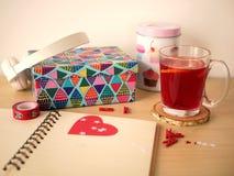 Libreta con una taza de té Foto de archivo libre de regalías