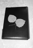 Libreta y hojas Imagen de archivo