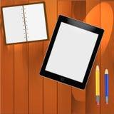 Libreta y lápices en la tabla ilustración del vector