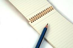 Libreta y lápiz Imagen de archivo