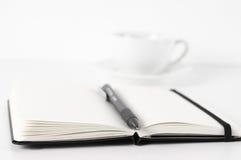 Libretas con la pluma y el café Foto de archivo