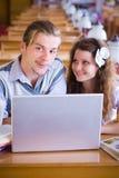 Libri & computer portatile di Studing Immagine Stock