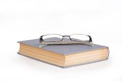Libri con i vetri su  Immagine Stock