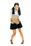 Libri del mucchio della stretta della donna dell'allievo Fotografia Stock Libera da Diritti