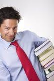 Libri dell'uomo d'affari Immagine Stock