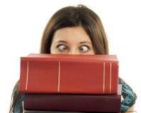 Libri dello studente ed occhi attraversati Fotografia Stock