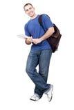 Libri di trasporto dell'allievo maschio su bianco Fotografie Stock