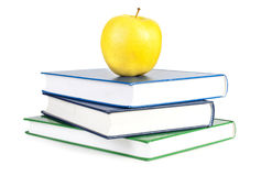 Libri e mela Immagini Stock