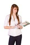 Libri e scomparto svegli della holding della ragazza Fotografia Stock Libera da Diritti