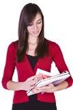 Libri e scomparto svegli della holding della ragazza Fotografia Stock