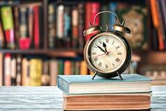 Libri e sveglia Immagine Stock Libera da Diritti