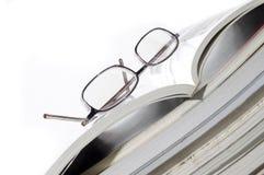 Libri e vetri di lettura Fotografia Stock